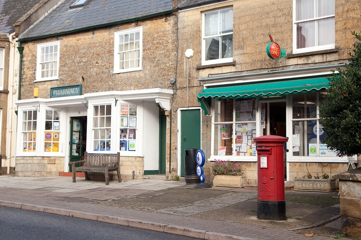 Beaminster's wonderful independent Pharmacy next to the Post Office on Hogshill Street  photograph © natamagat.co.uk