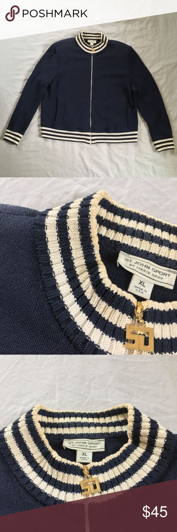 St. John Nautical knit zip up sweater Great quality knit zip up from St. John Marie Gray.  Has light padding in the shoulders, removable if desired and two pockets in the front.  Zip up is in great condition, no tears, or pulls, but needs a trip to the dry cleaners, to remove slight discoloration from the collar and wrists.  Nautical navy blue and white stripes on collar, waist and wrists, with gold hardware accents.  This is a great sweater to wear on beach nights and out on the boat!  72%…