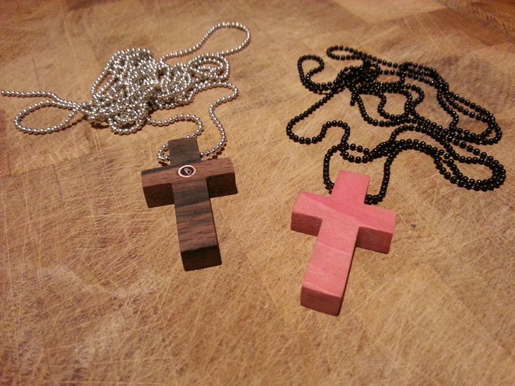 IMNLV Makassar and pink ivory wood cross necklaces.