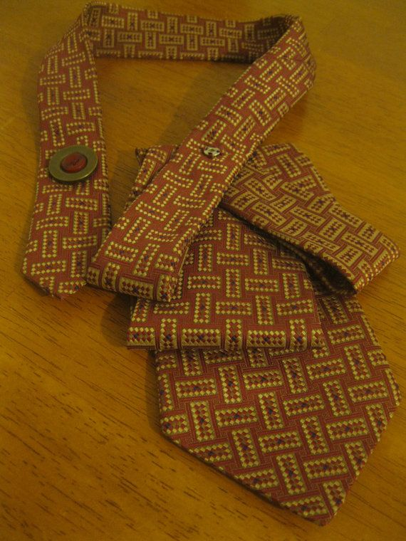Upcycled tie necklace featuring a fun abstract tie in gorgeous shades of…