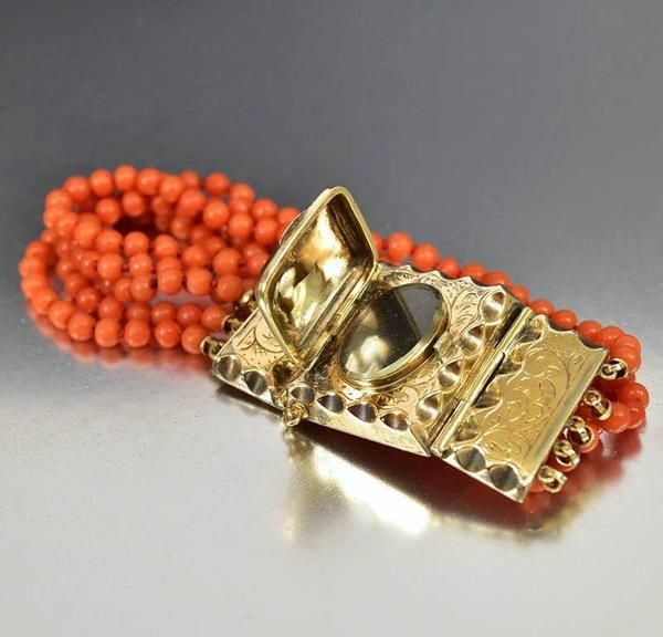 Ravishing Victorian era, circa 1880s, five strand coral bead braceletfeaturing an elaborately gold engraved locket clasp with side panels. Rendered in a warm #antiquebracelets