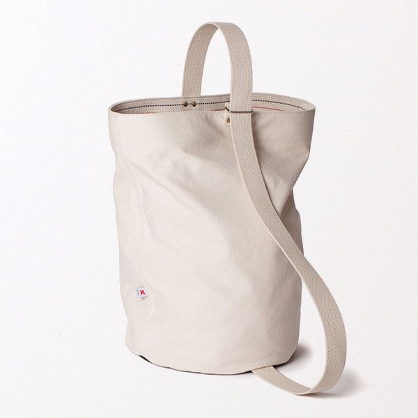 The Bucket Bag by Best Made Company. 18oz duck canvas sidewalls with brass rivets and a 24oz black canvas duck base. $62