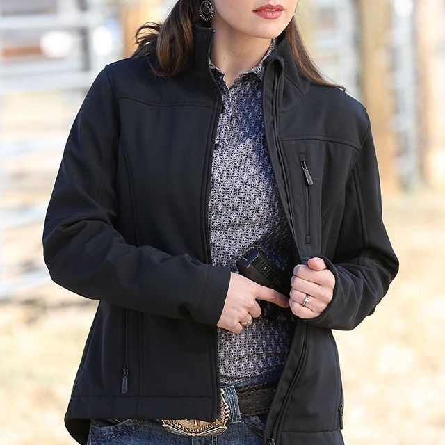 Be a modern cowgirl in the new Cinch Womens Concealed Carry Logo Softshell Jacket