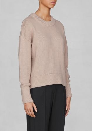 A knitted cotton-blend sweater with a relaxed, elegant silhouette and a wide rib-knit collar.
