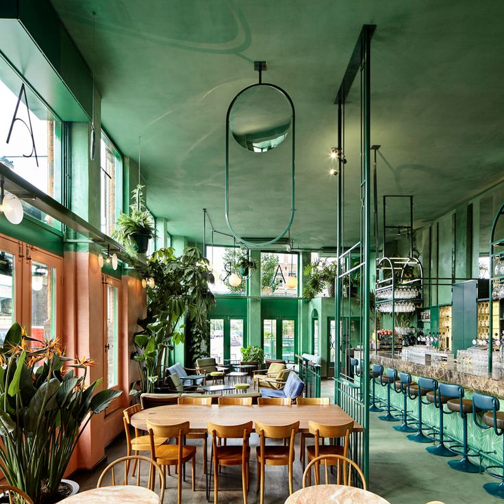 Rainforest foliage and mirrors feature inside Amsterdam bar by...