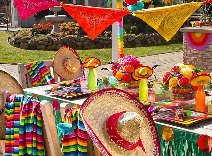 Sombreros and Serapes are such versatile fiesta supplies. Fill brims with tortilla chips, Use for table decor, photo booths, etc. #fiestasupplies #fiesta #cincodemayo