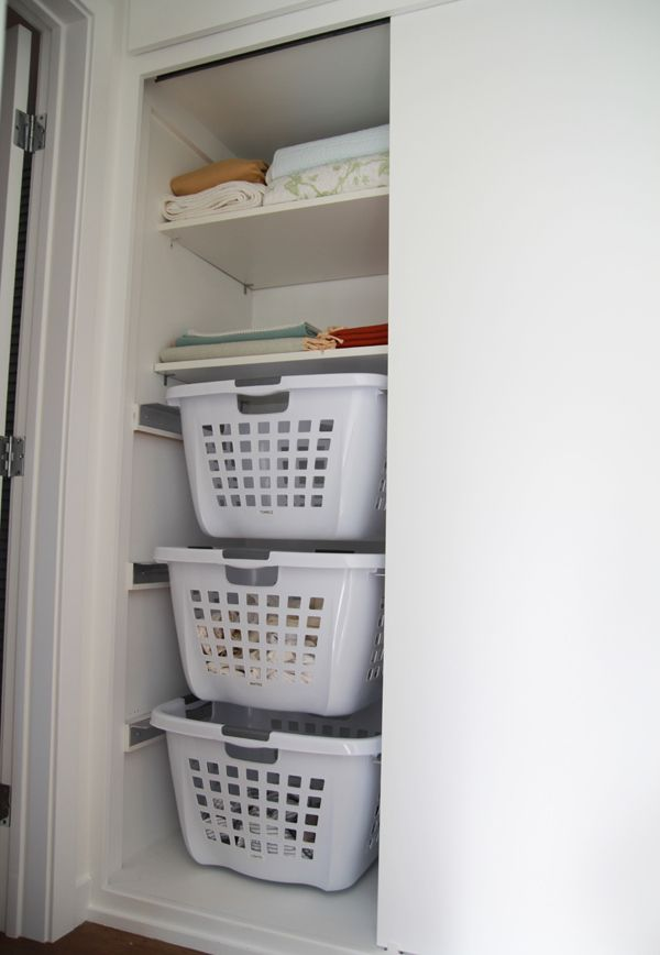 DIY hanging laundry baskets. First, they be in Different Cupboards. Lengthwise Rectangular, NOT Vertical. Then I'd find Nicer Baskets, maybe Cloth/Wire ones.... But it's the European Drawer Slides that make it able to SUPPORT weight!
