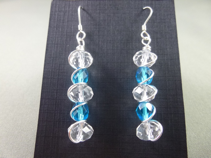 Faceted blue and clear glass beads wrapped with a non-tarnish silver wire and finished with sterling silver earwires.
