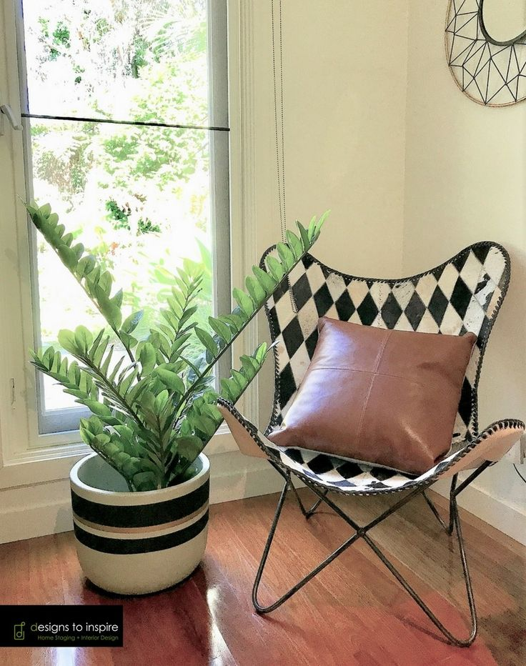 Tuesday trend - Butterfly chairs #designstoinspire #style #butterflychair #blackandwhite #tan #pillow