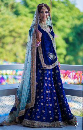 Bridal Wear - Vivaan & Shreya | WedMeGood | Royal Blue Wedding Blue Lehenga with Light Blue Net Dupatta and Gold Bootie Embroidery #wedmegood #indianbride #indianwedding #lehenga #bridal #blue #jewelry