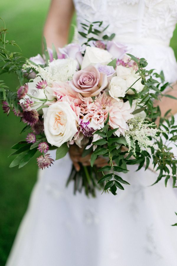 Blush and lilac rose, chrysanthemum and astilbe wedding bouquet: http://www.stylemepretty.com/2016/12/19/food-wine-hip-hop-music-our-kind-of-wedding/ Photography: Corina V. - http://corinavphotography.com/