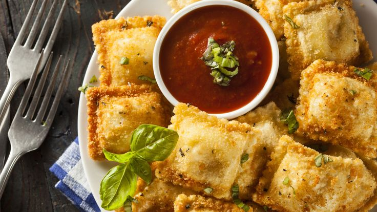 Examining the mysterious past of St. Louis toasted ravioli   In Italy pasta cooked any way other than al dente is considered inedible. Frying it? That would be sacrilege. But in St. Louis ravioli thats both breaded and fried in a vat of bubbling oil is revered.   There are a few foods that hold a special place in the hearts and minds of St. Louis natives gooey butter cake ribs and St. Louis-style pizza  but depending on who you ask toasted ravioli might be the most iconic food born in the…