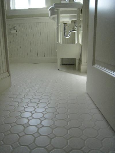 I like the white floor tile.  Epoxy grout, which is plasticized grout and more expensive than regular grout was used on this floor tile installation.  Epoxy grout is very stain resistant... no sealing or staining.