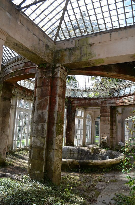 An abandoned greenhouse in Staffordshire, England, within the Alton Towers Gardens.