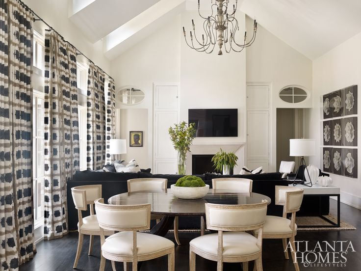 Style meets function in the combination living-dining room of this Buckhead residence by interior designer Melanie Turner and associate Jill Tompkins. To keep the aesthetic masculine, stylish, but also fresh, they began by selecting a bold Scion fabric for the draperies