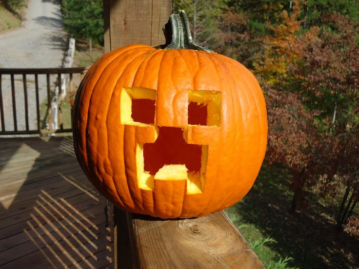 Here's an idea for all you Minecraft fans! Why not carve a creeper pumpkin? All you need to cut is squares and rectangles, which makes it super easy and super fun.