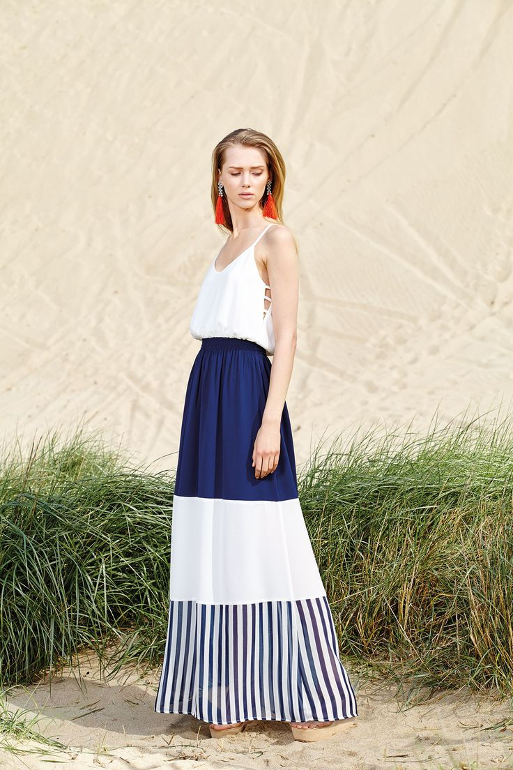 A 9-5 p.m maxi dress in white and navy shades will never disappoint you!