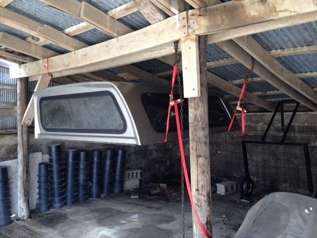Use ratchet straps to hold pick-up truck topper up off of ...