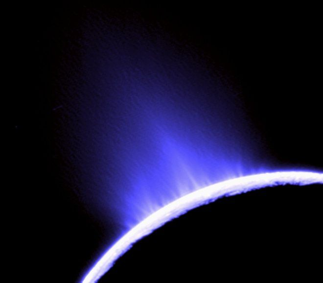 """GEYSERS OF ENCELADUS  >>>>  Geoff Marcy also chose this photo of water geysers spouting from Saturn's moon Enceladus, taken by Cassini in October 2007. """"This is the best destination to search for life,"""" Marcy wrote. Astronomers think the geyers could indicate Enceladus harbors an ocean of water buried underneath its surface, which might support microbial life."""