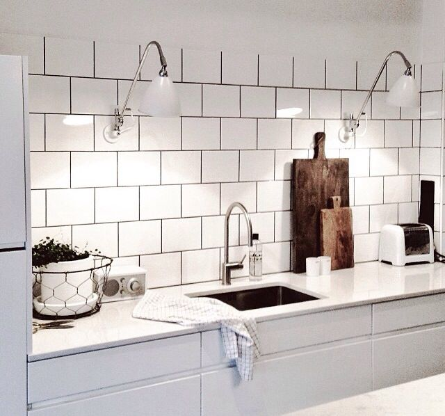 Its a kitchen but i would LOVE this look for a laundry, with the white tiles and black grout, wee lights etc