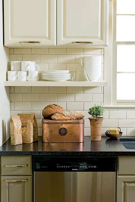 Raised cabinets with open shelf beneath. Kitchen of Anne Turner Carroll
