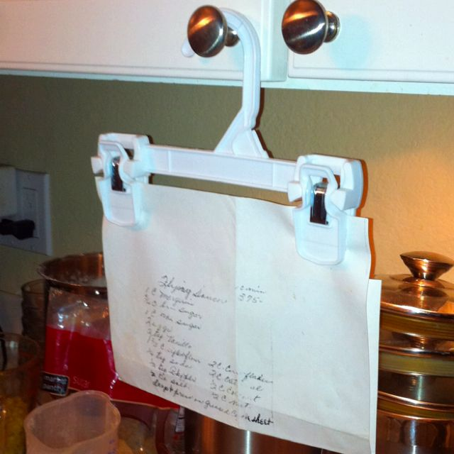 Impromptu recipe holder! Let's you look at the recipe more closely than if it were on the counter!  Even better than the clothespin to the door handle that I use.