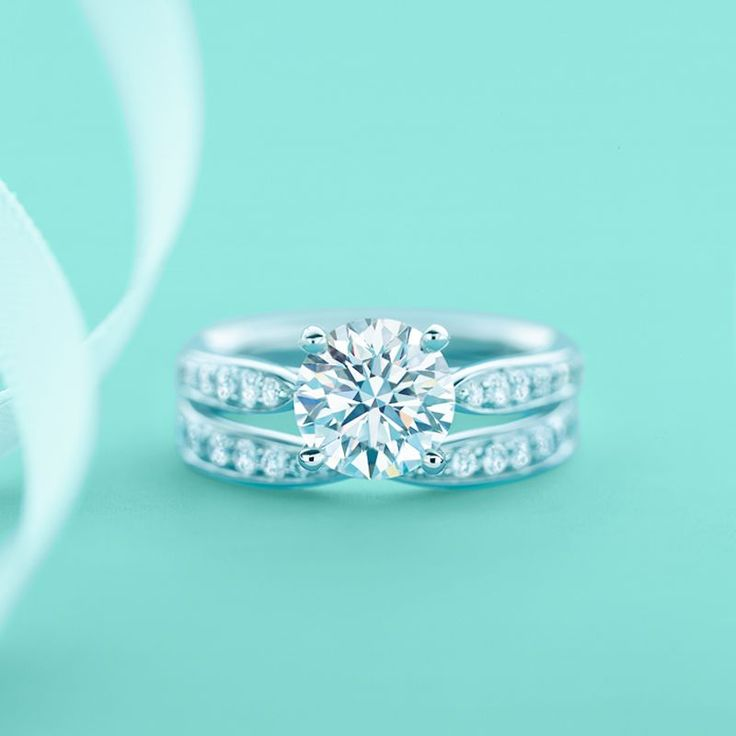 A harmonious couple, indeed. A Tiffany Harmony® engagement ring and wedding band with diamonds. #wedding #rings