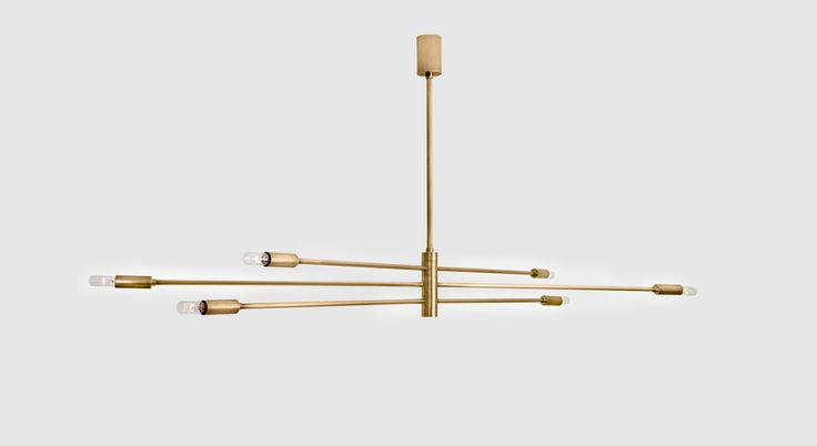 Handmade ceiling fixture in oxidized bronze with three horizontal arms with light sources on either end.