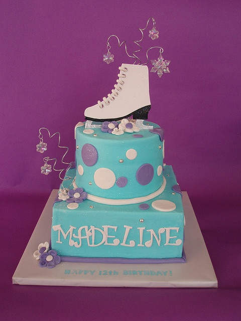 My figure skater daughter would love this.  Ice Skating Themed Cake by CakesUniqueByAmy.com, via Flickr