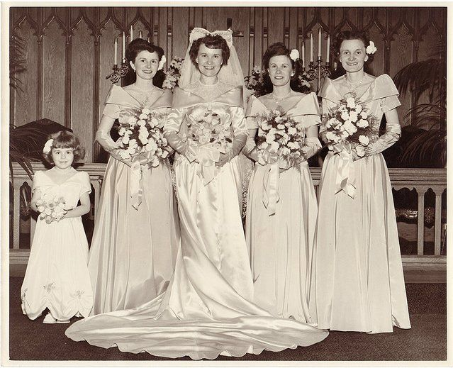 The bridesmaids' dresses mirrored the style of the bridal gown in this 1949 wedding.  Source: Flickr user Mavenhaven
