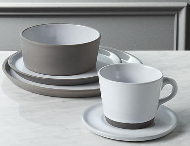 """The five-piece place setting includes a dinner plate, salad plate, soup bowl, cup, and saucer. The dishes are dishwasher- and microwave-safe. However, it is still recommended you hand-wash each piece. Promising Review: """"I really love the flat, gray finish on the outside. The size and weight are perfect and the whole set is very functional. I haven't had any issues with scratching, but I'm pretty gentle on dishware."""" —JessBGet the five-piece set from CB2 for $31.95."""