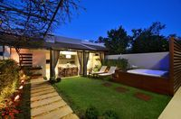Área de Lazer na cidade : Jardins rústicos por Stefani Arquitetura