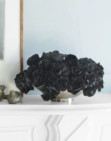How to make black paper flowers from crepe paper streamers.
