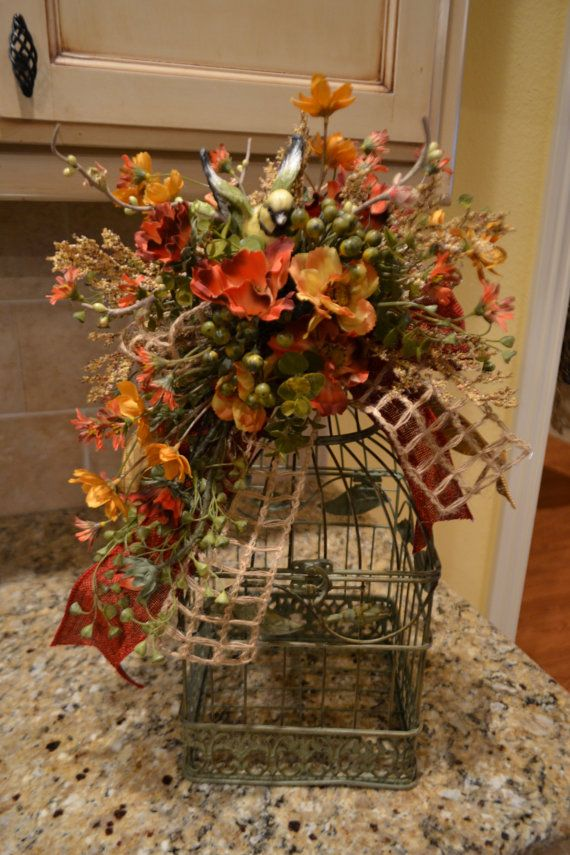 Floral Decor: Birdcage With Flowers And Bird