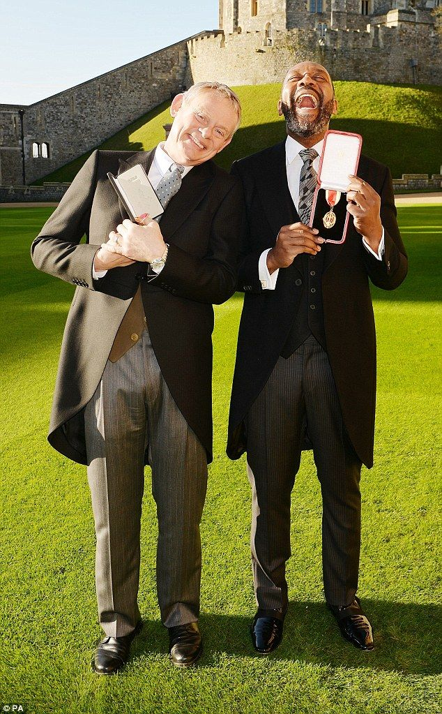 Sharing a laugh:Sir Lenny Henry, 57, and Martin Clunes OBE, 54, were recognised for their...