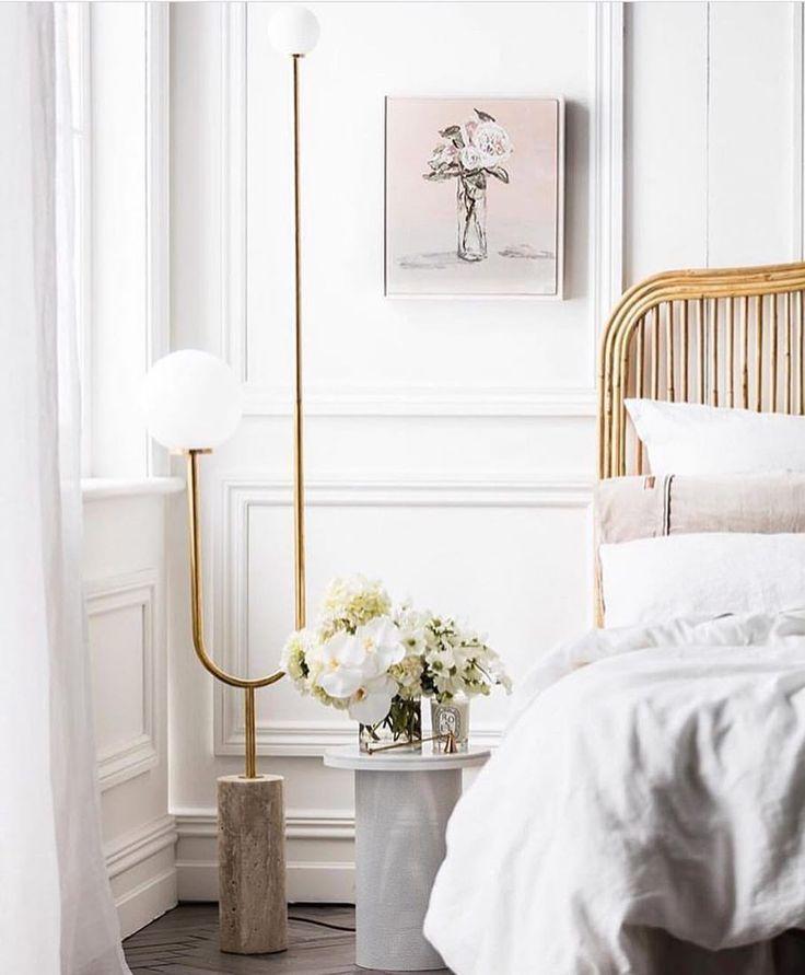 Statement brass mid century floor lamp in a Parisian inspired bedroom