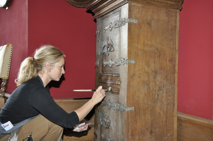 One of the museum's conservators at work in the exhibition