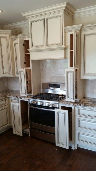 Stove wall. Wood hood cover, counter height spice rack ...
