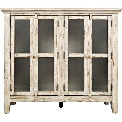 An understated design pairs with a colour block pattern to round out this 2-door cabinet. Use it to accent your living room in simply-chic style then fill its ample storage space with leather-bound books and objets d'art.