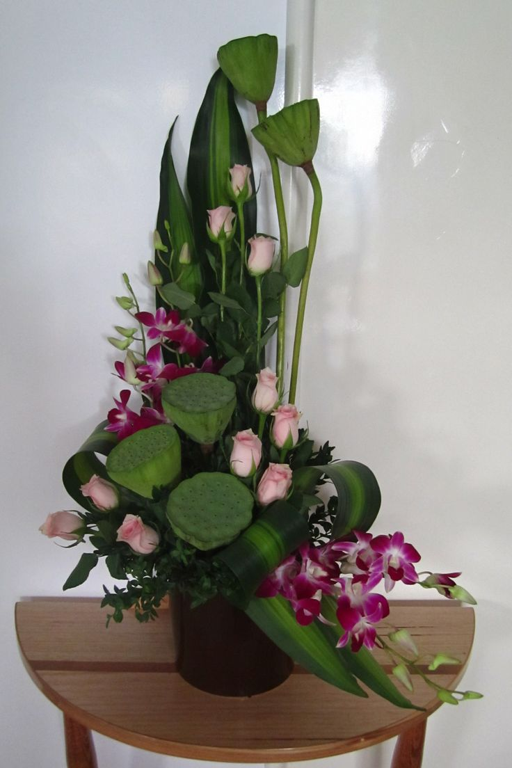 'L' shaped arrangement featuring the beautiful Lotus pods - from the lotus flower