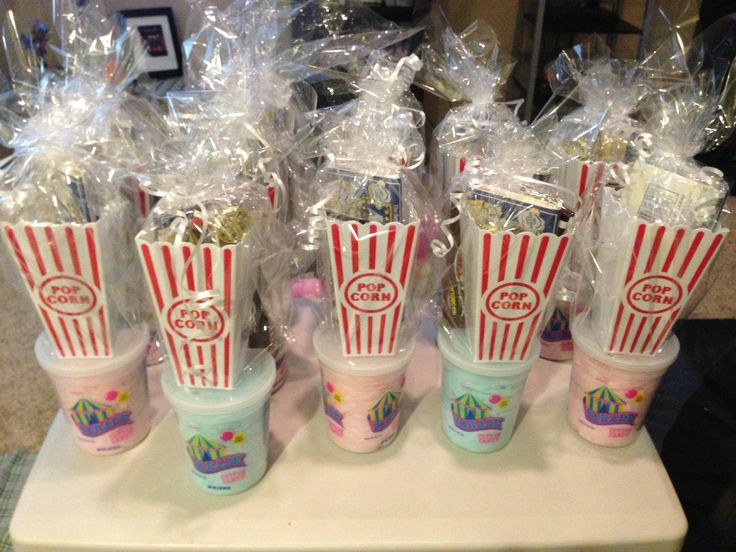 Party favors: Plastic popcorn container, box of movie candy, bag of popcorn, cotton candy, custom wrapper candy bar and a small movie award trophy.