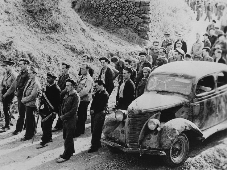 Falset, near Barcelona. Spain. Bidding farewell to the International Brigades, which the Republican government dismissed by the Republican government, as a consequence of Stalin's friendship with Germany. By Robert Capa, (October 25th, 1938)