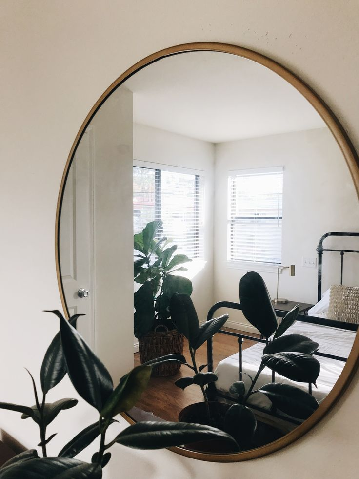 My bedroom ❤️ // Bed from Joss & Main, Mirror, planter basket, side table, and side table lamp from Target. Fiddle leaf from Costco. Rubber plant from Orchard Hardware. #targetstyle #myhouse #mybedroom #viewfrommymirror
