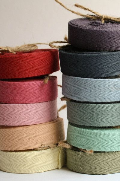Twill ribbon as a simple color/texture around brown paper wrapped 'item' $8 for five yards or a bulk 72 yards (not sure about price on that)