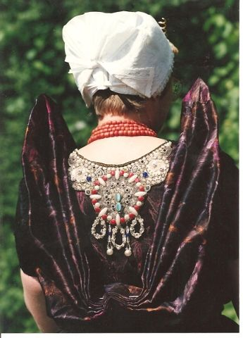 "Netherlands, Zeeland. This costume is worn in the town of Axel. The embroided part on the front and back is called a "" beuk""."