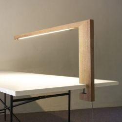 Straight lines, raw wood and high tech to make it shine. Timp is an unusual desk lamp by Lutz Pankow.: