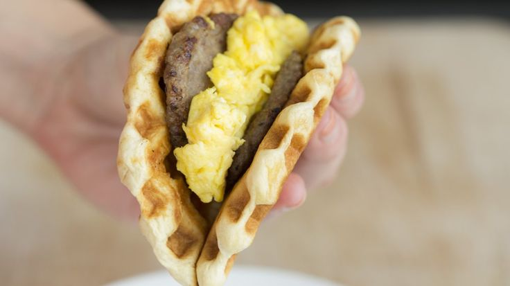 Pillsbury® Grands!® biscuits prepared in a waffle maker are the perfect base for a sausage and egg waffle taco.