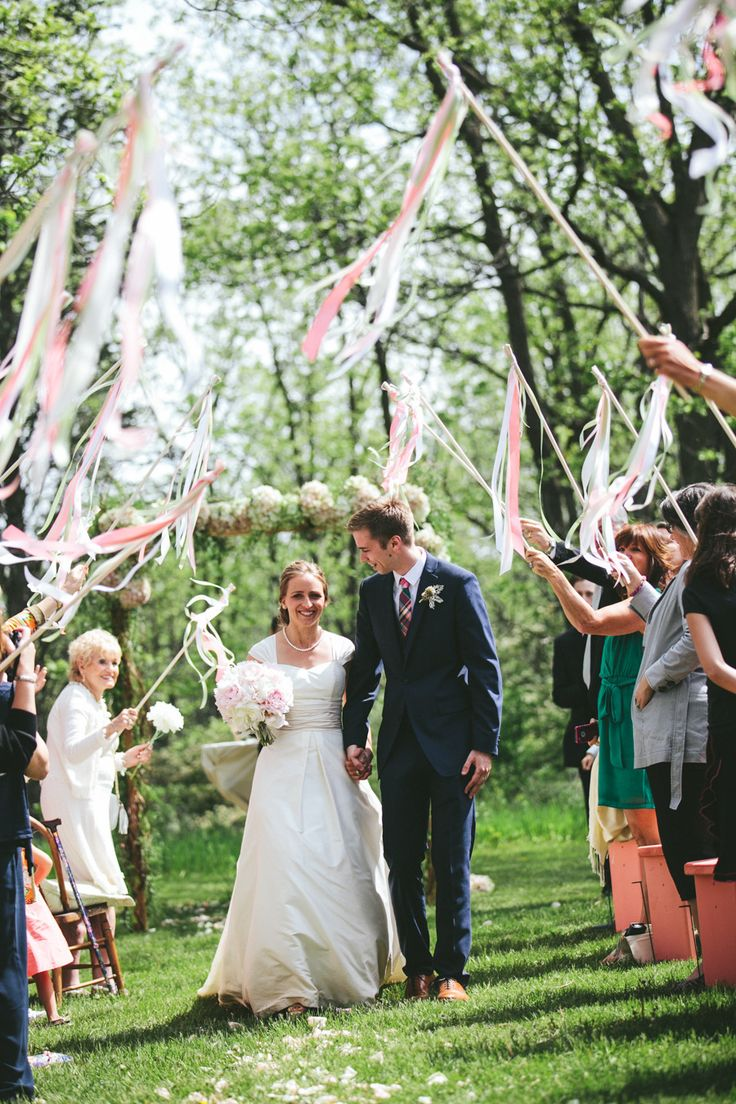 "#streamers #happilyeverafter #wedding Celebrating after the ""I Do's""  Photography by woodnotephotography.com  Read more - http://www.stylemepretty.com/2013/08/29/wisconsin-wedding-from-woodnote-photography-2/"
