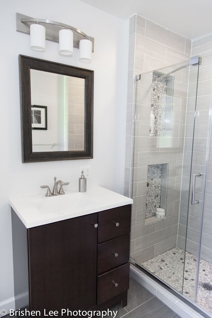 Two Shower Nooks With Marble Pebbles And Horizontal Grey