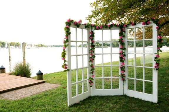DIY door panes into a wedding ceremony backdrop from Terri & Jim's small-budget, handmade Middle River wedding in Maryland